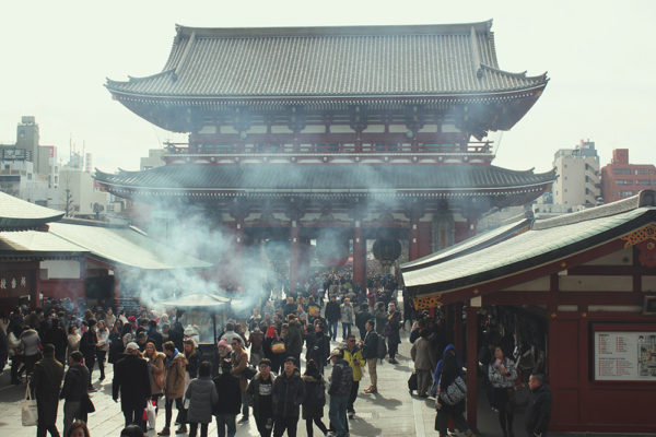 Looking back from the main temple towards the gate and the incense smoke.