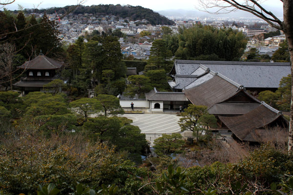 A view of Ginkaku-ji from above with the city in the background